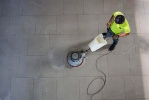 A man cleaning the floor in a commercial building