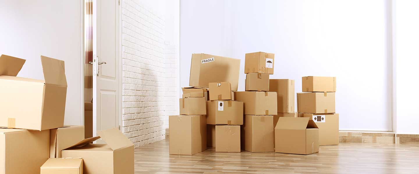 Moving boxes stacked up and ready to be taken away by a moving company
