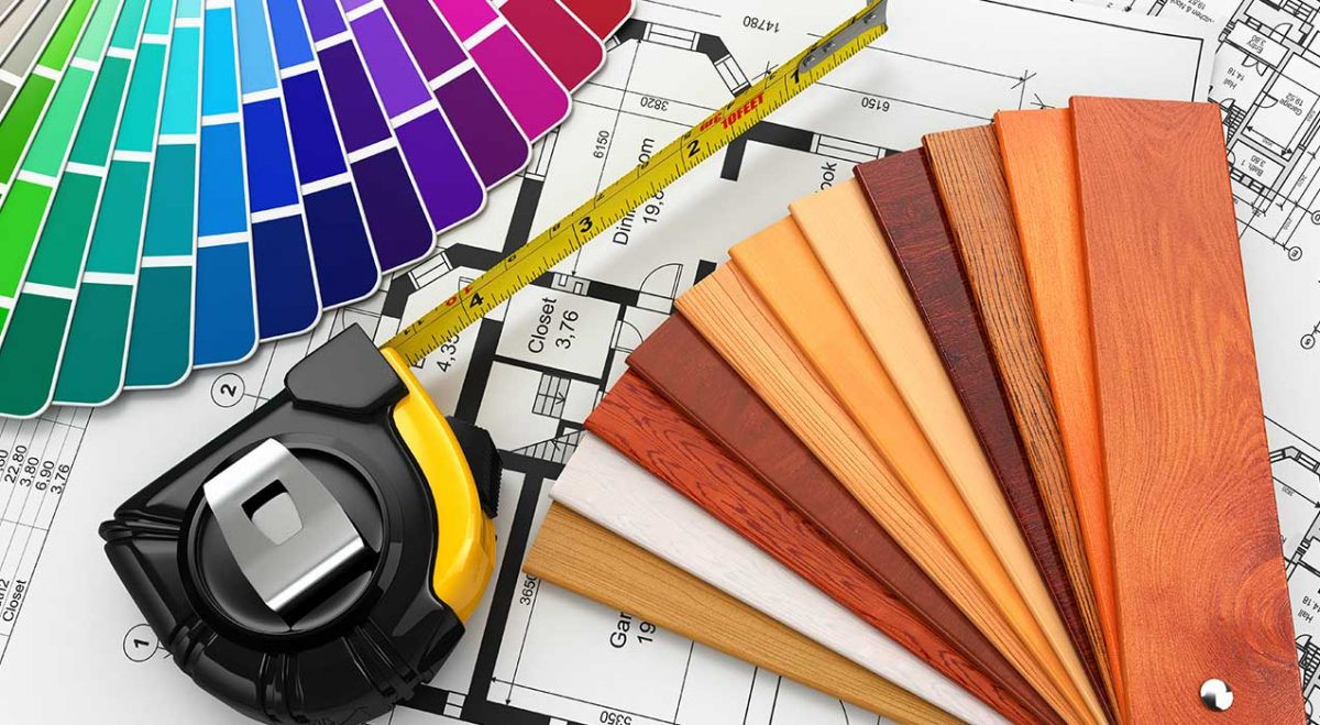 Various tools for home improvement such as paint swatches and measuring tape
