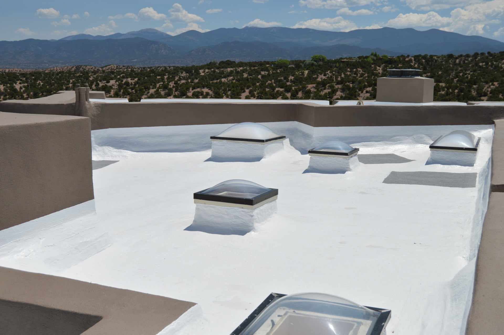 Roof that has a new rubber roof coating applied