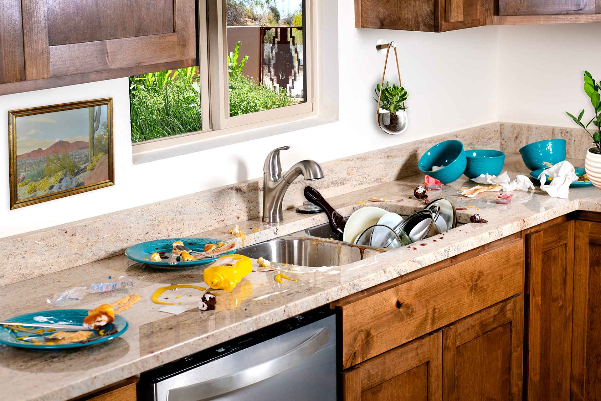 A sink filled with dishes and a counter covered with food in a house that needs housekeeping