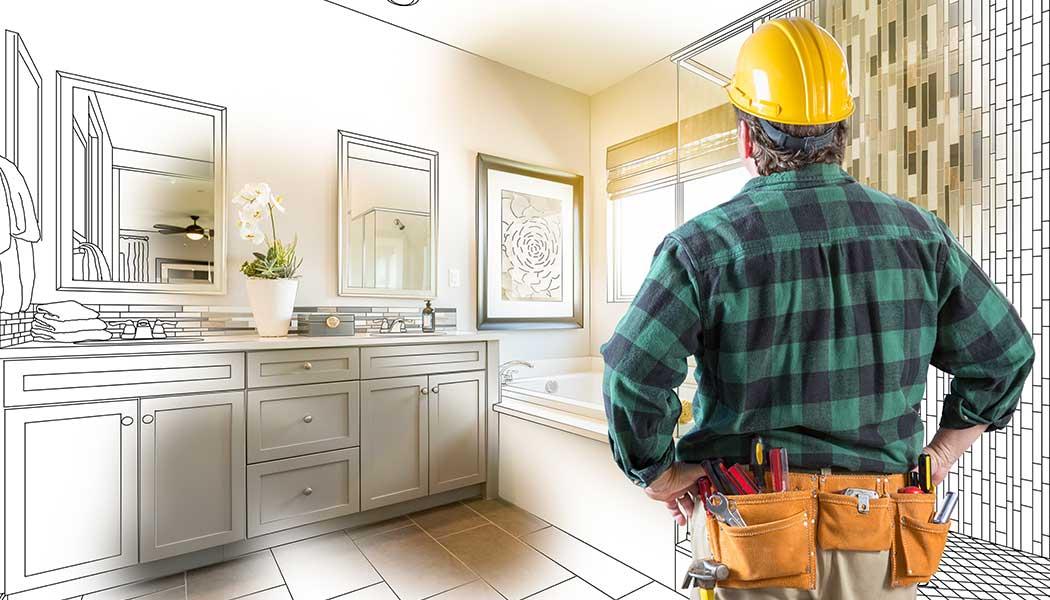 A contractor examining a bathroom remodel